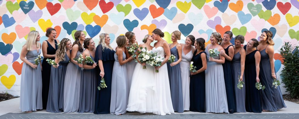same sex wedding photographer confetti hearts wall